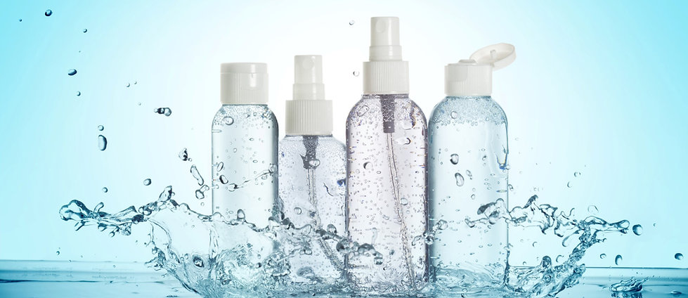 variety of clear bottles with a splash of water