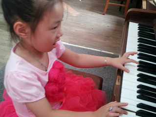 She is playing hard the piano.