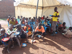 Lwengo children and orphans at lunch