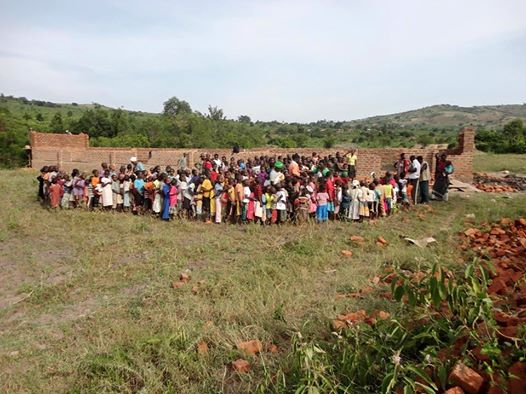 Lwengo children view school build