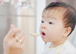 How can I start to wean my baby onto solid foods?