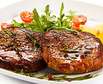 Beef Steak on platter with salad
