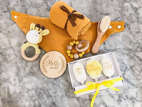 Yellow baby gift box with matching cake pops