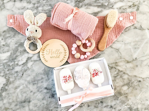 Pink baby gift box with matching cake pops
