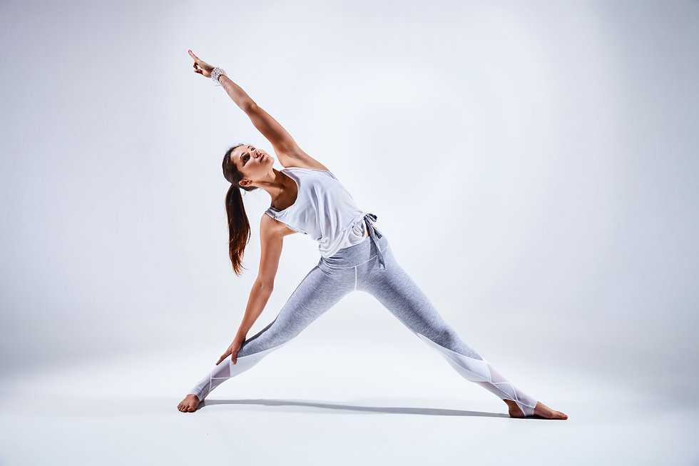 Sporty young woman doing yoga practice i