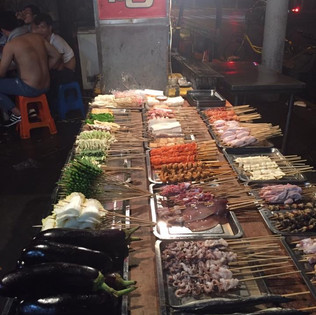 A street food night market in Shanghai, delicious and cheap