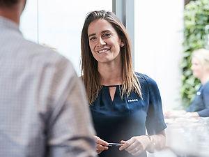 Lady smiling at a customer