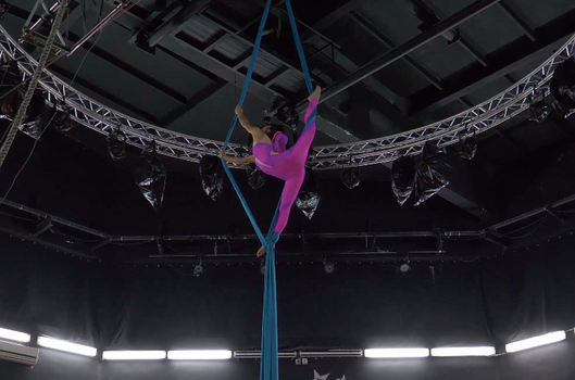 the aerial silks show act performed by professional circus artist Rika