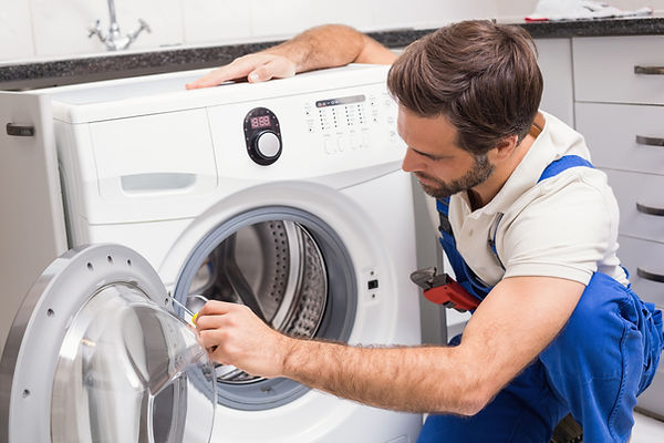 handyman-fixing-a-washing-machine.jpg