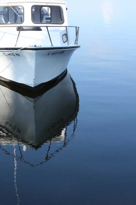 Boat Reflected in Blue Water