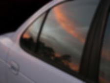 Sunrise Reflected on Car Window