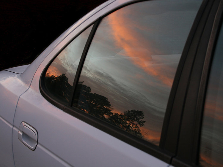Sunrise Reflected on Car Window