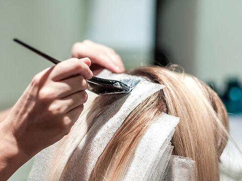 lady's hair colour foil tint highlights application