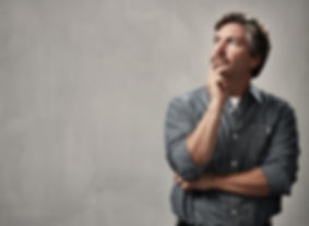 Thinking caucasian man portrait over gra