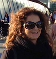 Woman with a smilling face wearing Sun glass