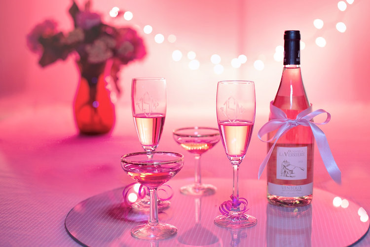 Wine Glasses and a bottle on a decorated table
