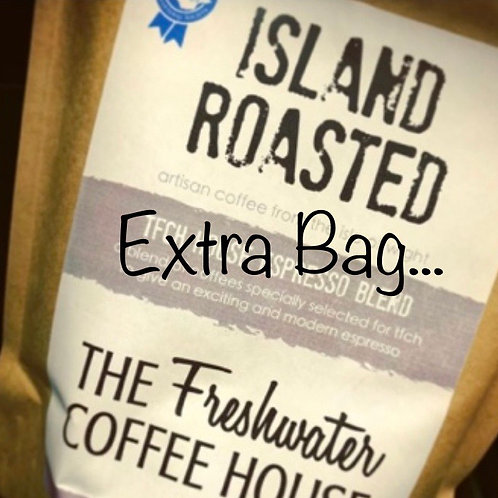 Add a bag of ground coffee (or extra bag to keep cups and brew ware purchase)