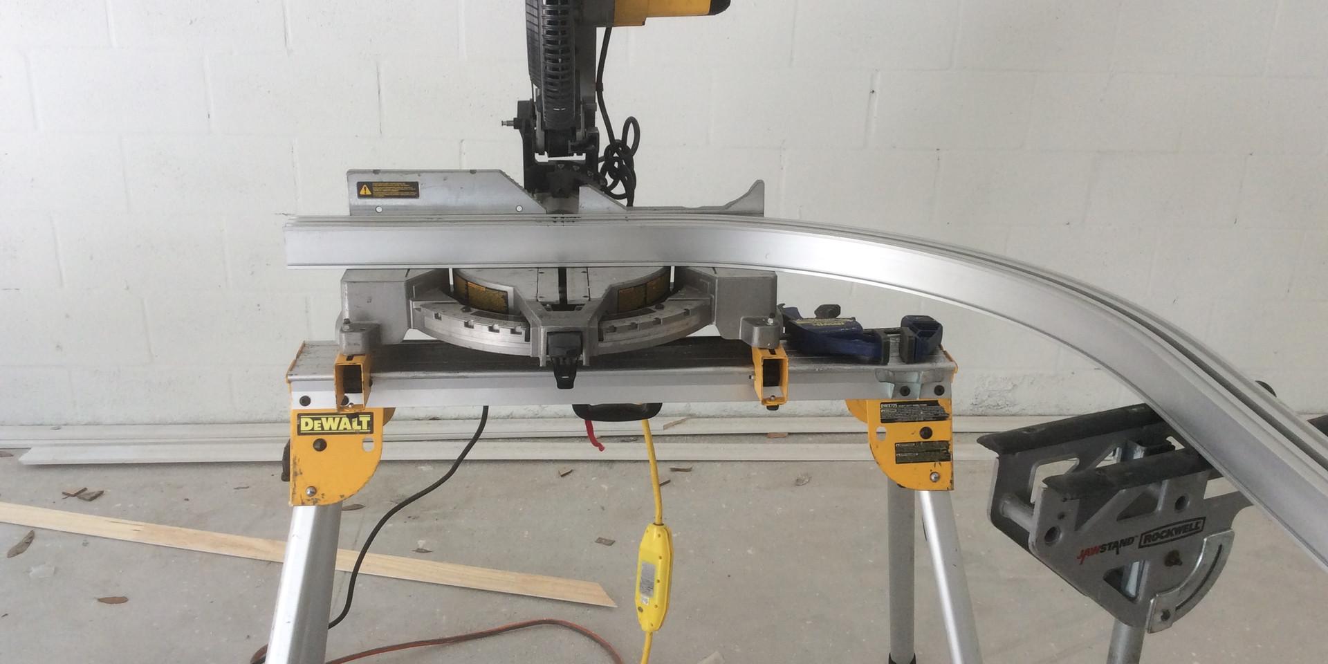 Precision cutting curved rail