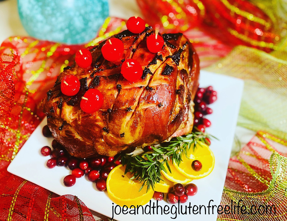 A delicious and easy to make roasted ham with maple syrup brown sugar and an orange sauce.