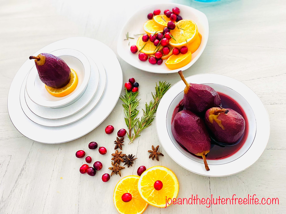 Poached pears in sweet red wine reduction with aromatics and spices. A classic Holiday treat!  Ingredients 4 to 6 pears, peeled 6 cups of sweet red wine or Burgundy wine 1/4 cup of sugar 2 star anise 8 cloves 1 stick of cinnamon 1/4 cup of freshly squeezed orange juice Method