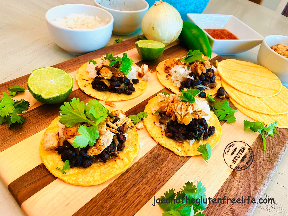 Easy to make cantina style tacos with chicken, black beans, rice, and more!