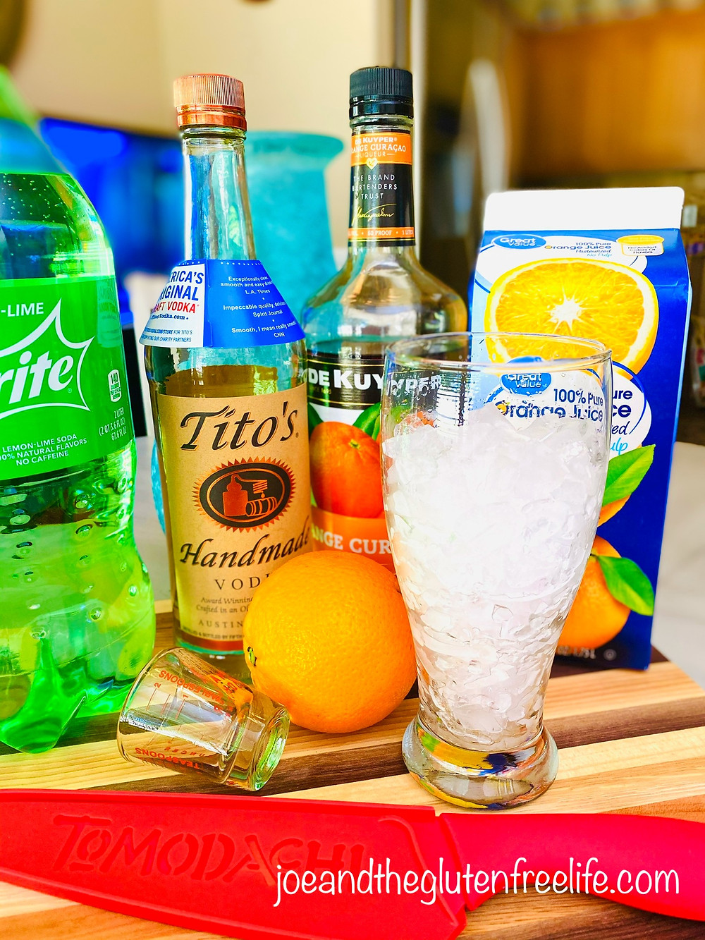 Refreshing and easy to make orange cocktail made with orange curaçao, Sprite, and vodka.