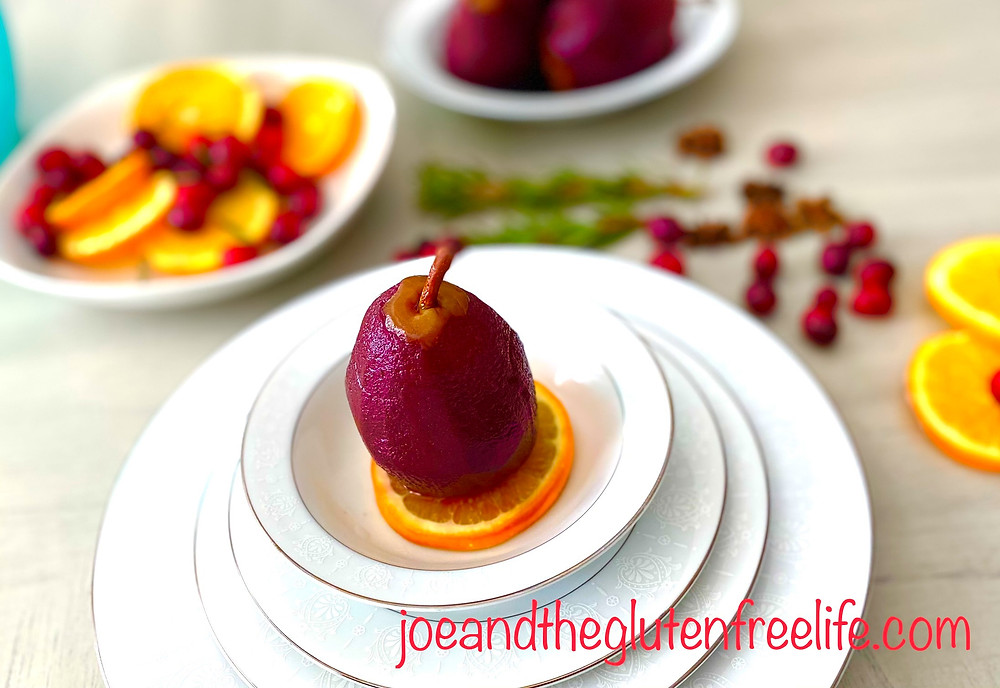Poached pears in sweet red wine reduction with aromatics and spices. A classic Holiday treat!