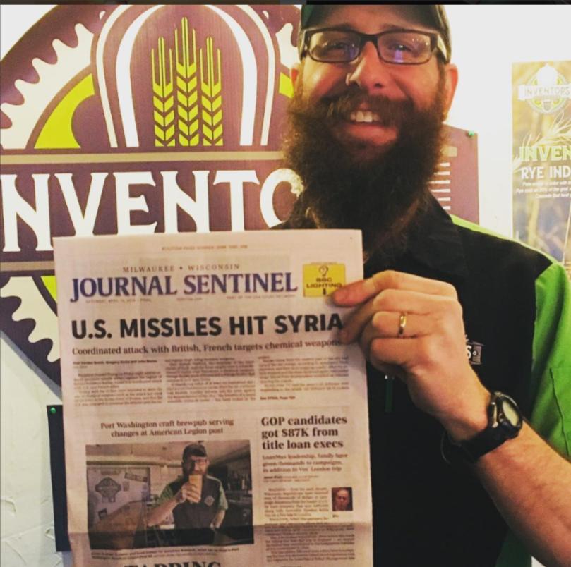 CaptnAdam holding MJS newspaper