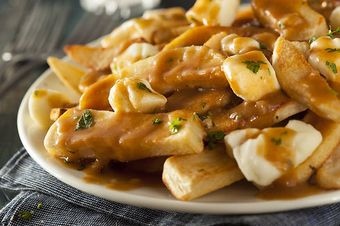 poutine - french fries covered with gravy with cheese curds on top