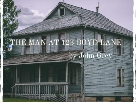 The Man At 123 Boyd Lane, John Grey