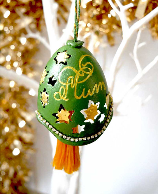 Hand crafted green bell ornament