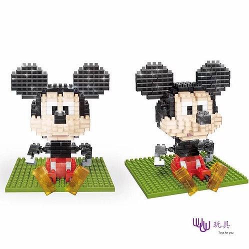 Mickey Mouse Sitting On The Grass
