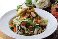 Green salad serve with chicken kebabs an