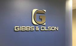 Gibbs & Olson Sign