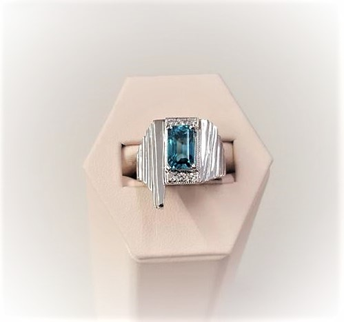 3.78ct Blue Zircon .20ctw Diamonds