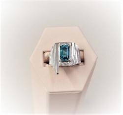 3.78ct Blue Zircon .20ctw Diamonds