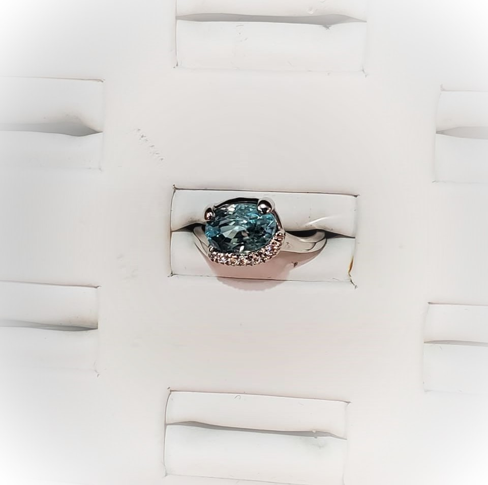 3.92ct Blue Zircon .10ctw Diamonds