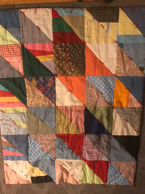 This vintage quilt will inspire our interior color scheme.