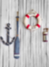 Composition on the marine theme with anchor, paddle and lifeline on old wooden background.jpg