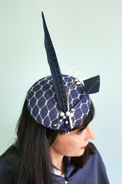 Sinamay Round hat with lattice veil , pearls and feathers