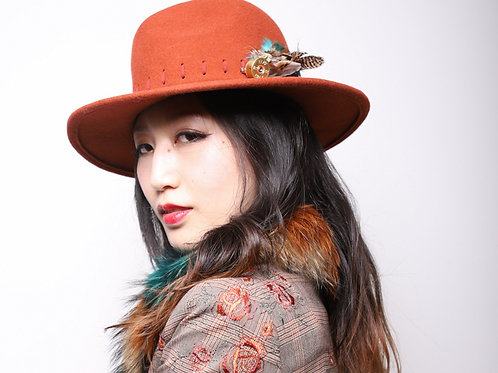 Rust/Terracotta trilby adjustable size with shotgun cartridge and feather detail