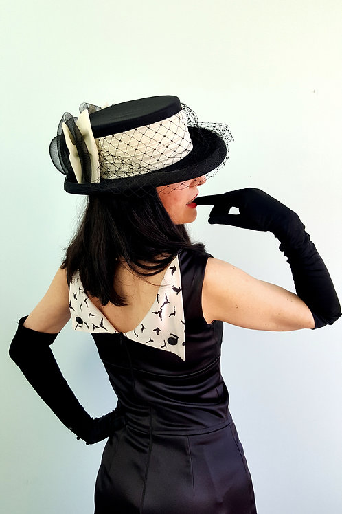 Vintage 1970's dressage style veiled hat in black and off white