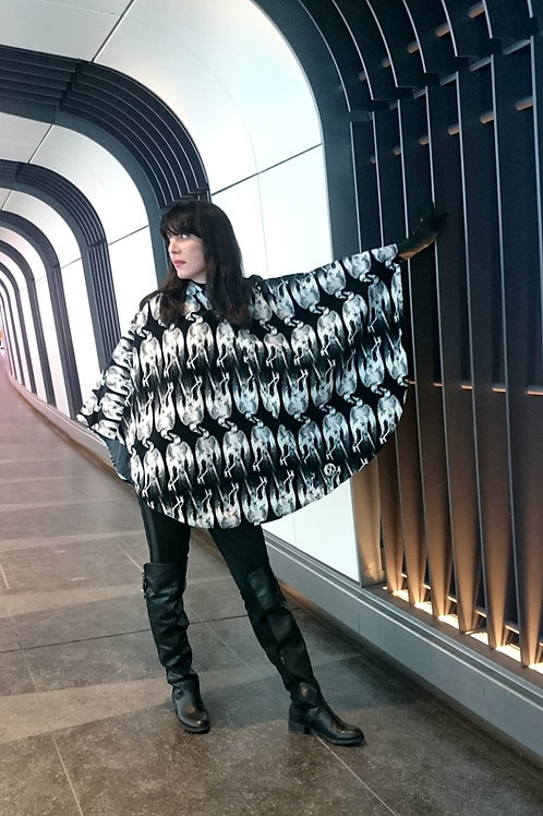 Skeletal bird Velvet/waterproofed wax hooded reversible poncho by Lee Lapthorne