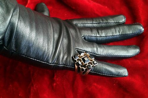 Gothic black crystal on golden metal ring
