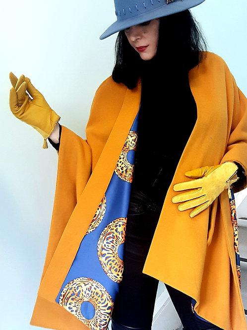 Saffron Montpelier wrap with leopard ring digital print on blue background