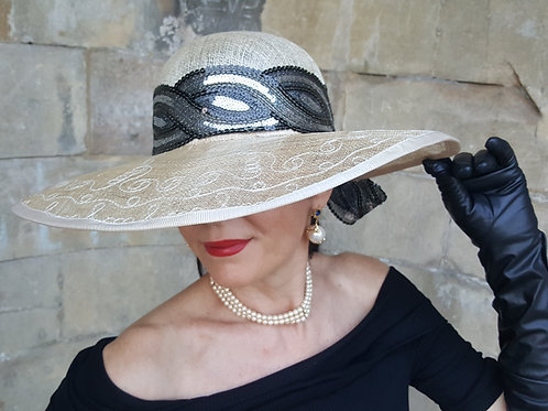 Sinamay sun hat with silver & black sequin crossover band