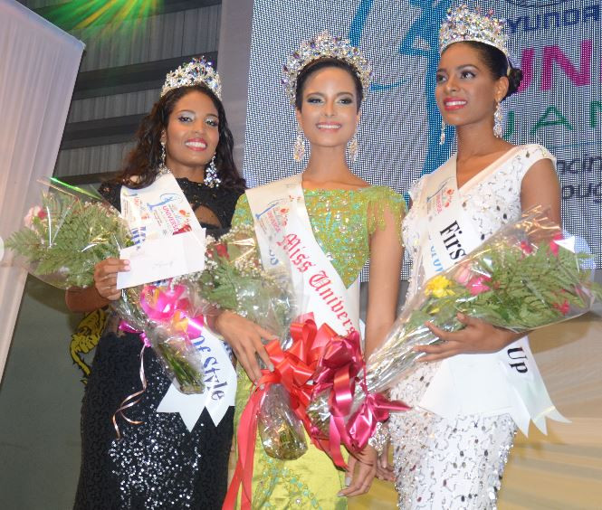 Kaci Fennell (centre) is flanked by second runner-up Kimar Muir (left) and first-runner up Roshelle McKinley