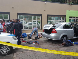 Gun battle wakes Amanzimtoti as armed business robbers finally caught in Doonside.