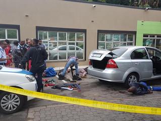 Gun battle wakes Amanzimtoti as armed business robbers finally caught in Doonside.