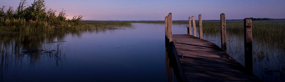 Photo of a lake and a deck gives the feeling of relaxation